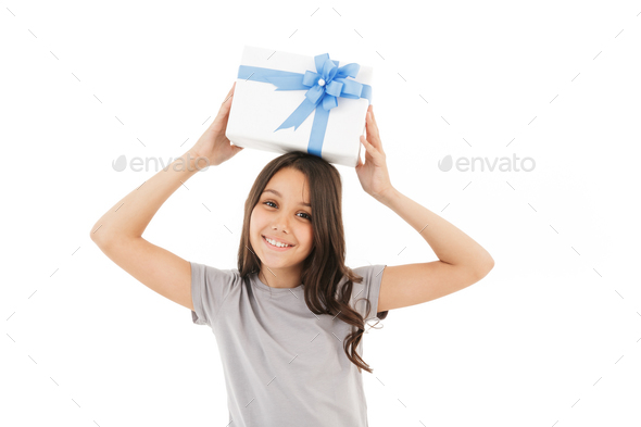 Happy girl standing isolated holding surprise gift box. - Stock Photo - Images