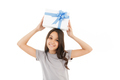 Happy girl standing isolated holding surprise gift box. - PhotoDune Item for Sale