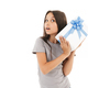 Cute girl holding surprise gift box. - PhotoDune Item for Sale