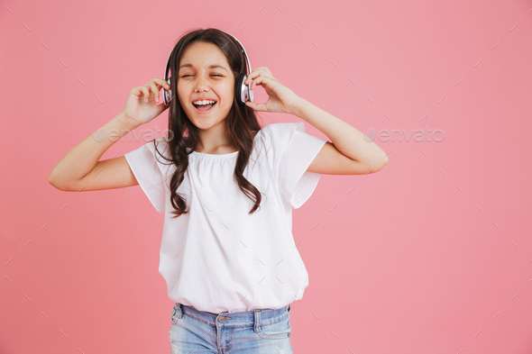 Joyful young girl 8-10 in casual clothing singing with closed ey - Stock Photo - Images