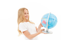 Picture of Smiling blonde girl in casual clothes holding globe - PhotoDune Item for Sale