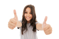 Pretty cute girl showing thumbs up gesture. - PhotoDune Item for Sale