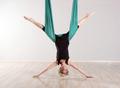 Single upside down woman doing aerial yoga splits - PhotoDune Item for Sale