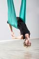 Upside down woman doing aerial yoga back bends - PhotoDune Item for Sale