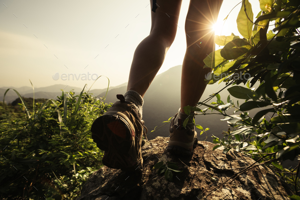 See the first sunlight on mountain top cliff edge - Stock Photo - Images