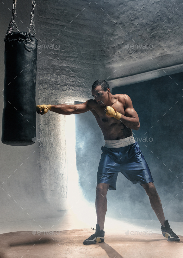 Boxing training and punching bag - Stock Photo - Images