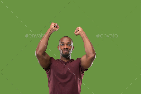 Winning success man happy ecstatic celebrating being a winner. Dynamic energetic image of male model - Stock Photo - Images