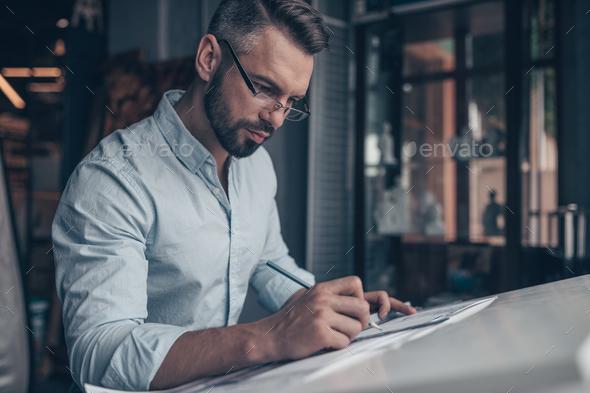 Young architect with drawing - Stock Photo - Images