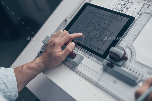 Architect with drawing - Stock Photo - Images