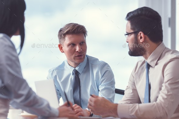 Young businesspeople at meeting - Stock Photo - Images