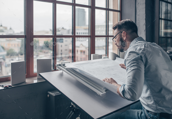 Mature architect in the workshop - Stock Photo - Images