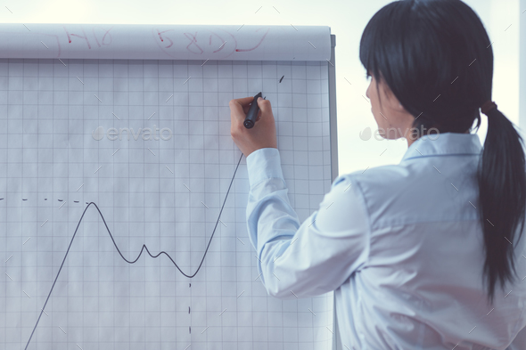 Young professional with flipchart - Stock Photo - Images