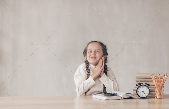 Happy little pupil with a book - Stock Photo - Images