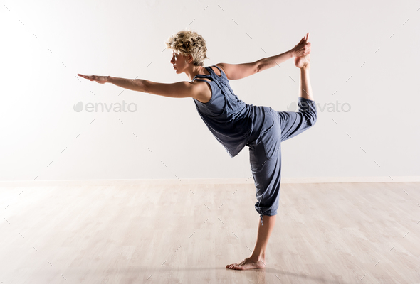 Woman in perfect balance while holding foot - Stock Photo - Images