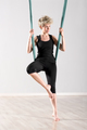Woman balancing herself with aerial yoga blanket - PhotoDune Item for Sale