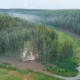 Drone Shot of Morning Fog Over Forests and River Valley - VideoHive Item for Sale