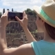 Woman Near Forum Romanum Taking Photo on Mobile Phone. Female Tourist Taking Picture of Roman Forum - VideoHive Item for Sale