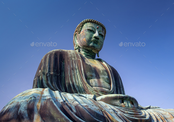 Giant Buddha statue under a blue sky - Stock Photo - Images