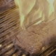 Steak Slipping on the Grill with Fire - VideoHive Item for Sale