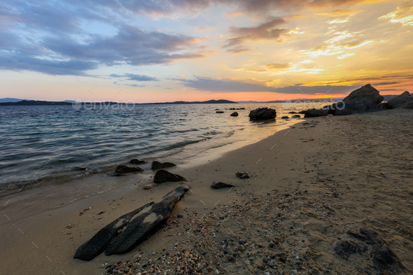 sunset on the beach - Stock Photo - Images