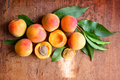 Ripe apricots on the old wooden background. Top view - PhotoDune Item for Sale
