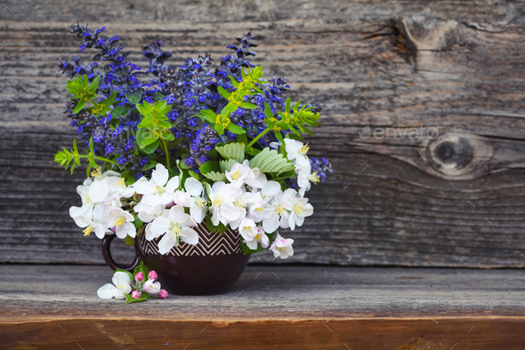 Bouquet of spring flowers on an old wooden background - Stock Photo - Images