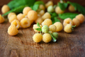 Ripe yellow raspberries on the old wooden background - PhotoDune Item for Sale