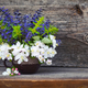 Bouquet of spring flowers on an old wooden background - PhotoDune Item for Sale