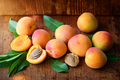Ripe apricots on the old wooden background - PhotoDune Item for Sale