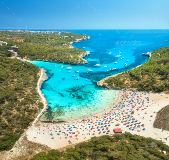 Aerial view of sandy beach, blue sea, people and yachts - Stock Photo - Images