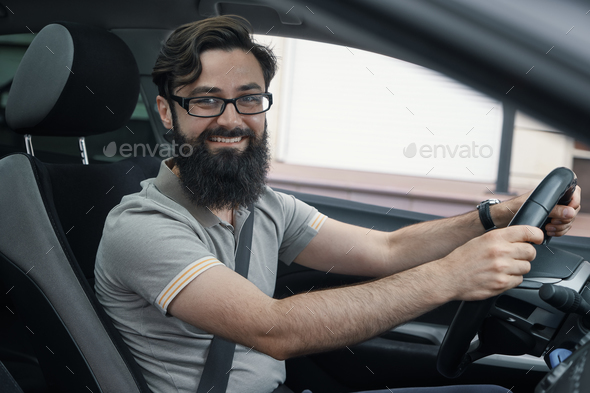 Happy car driver with fastened seat belt - Stock Photo - Images