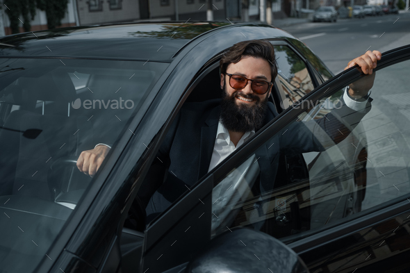 Portrait stylish, handsome man near car outdoors - Stock Photo - Images