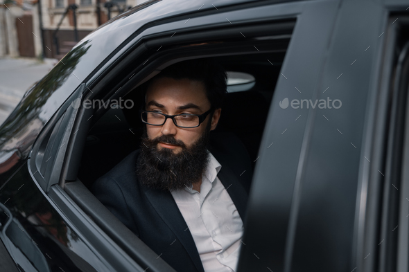 Close up portrair attractive young businessman in a car - Stock Photo - Images