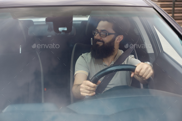 Happy driver with safety belt fastened - Stock Photo - Images