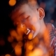 Cute Boy Eats Marshmellow Near the Wood Fire on Picnic - VideoHive Item for Sale