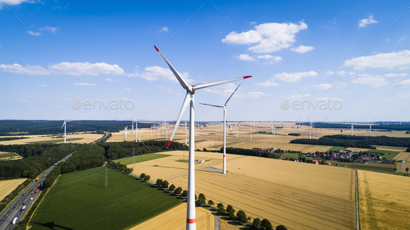 Aerial view of windmill against blue sky - Stock Photo - Images