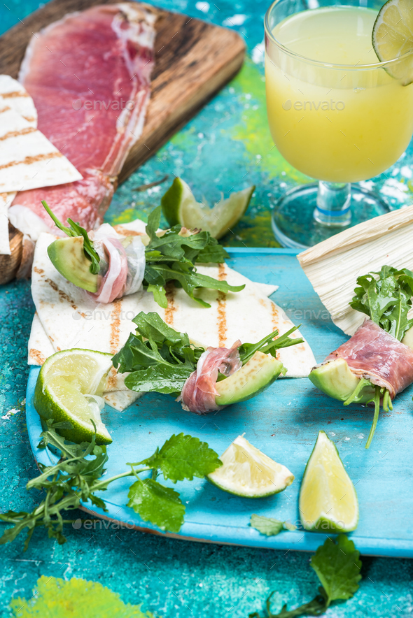 Avocado wrapped in parma ham and rocked salad - Stock Photo - Images