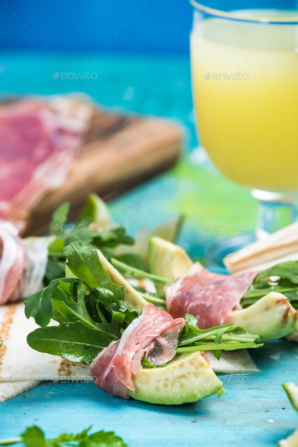 Healthy brunch, avocado wrapped in ham and salad - Stock Photo - Images
