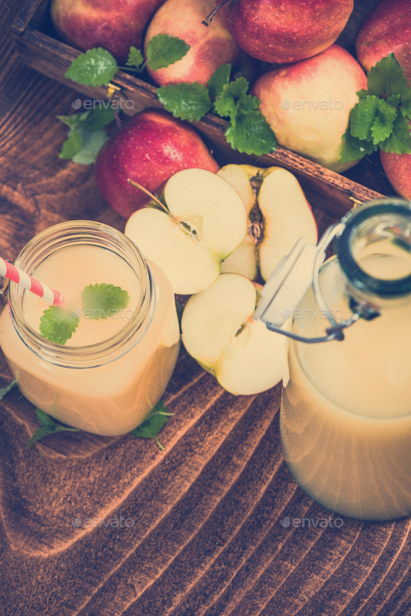 Freshly pressed cloudy apple juice - Stock Photo - Images