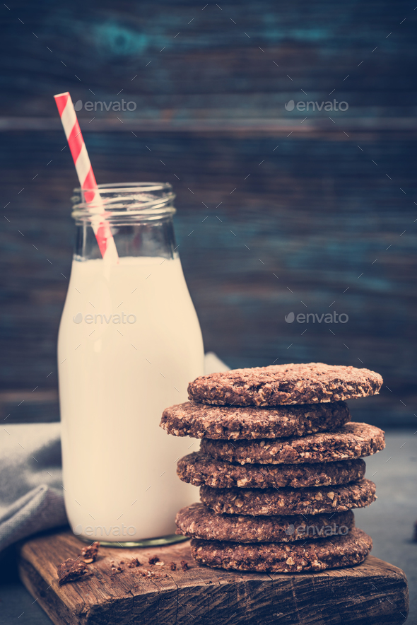 Milk bottle with healthy cookies - Stock Photo - Images