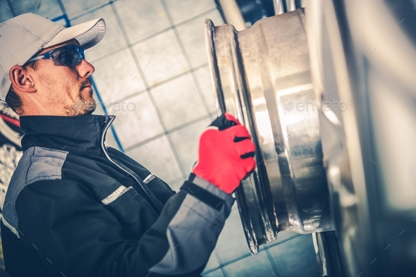 Worker and the Alloy Wheel - Stock Photo - Images