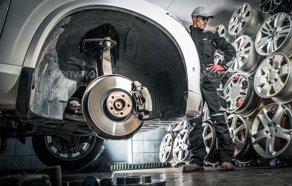 Choosing Car Alloy Wheel - Stock Photo - Images