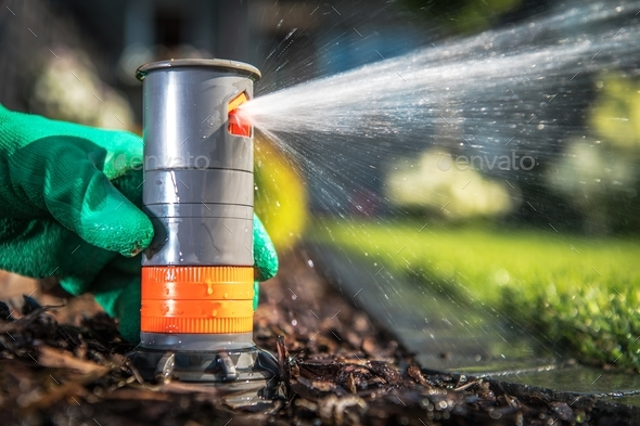 Underground Sprinkler System - Stock Photo - Images