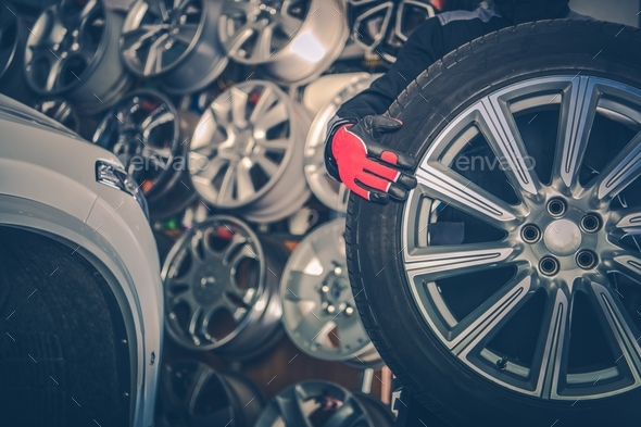 Picking New Alloy Wheels - Stock Photo - Images