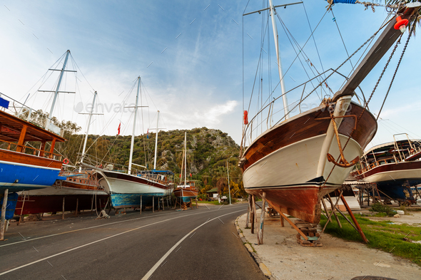 Vintage boats waiting fo reparation - Stock Photo - Images