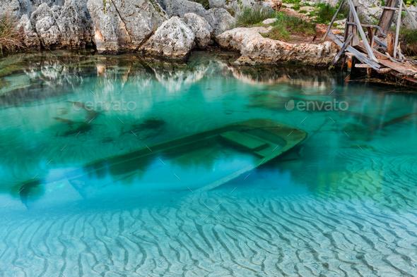 sunken wooden boat - Stock Photo - Images