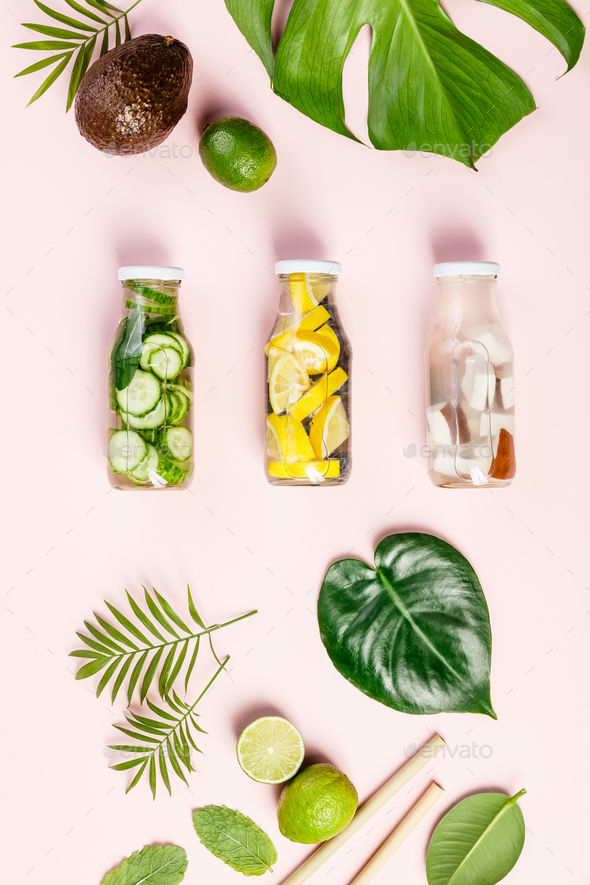 tropical fruits and leaves and infused water - Stock Photo - Images