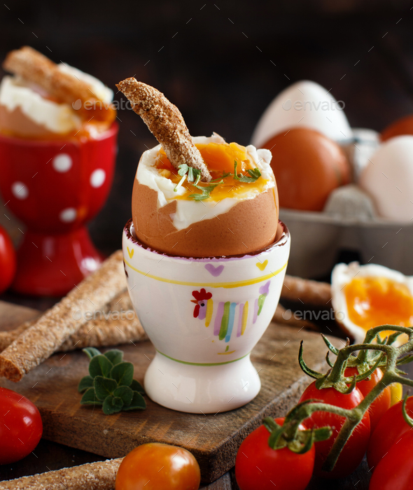 Soft-boiled egg with crisp bread - Stock Photo - Images