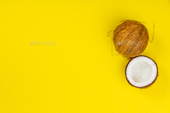 Coconuts on yellow background - Stock Photo - Images