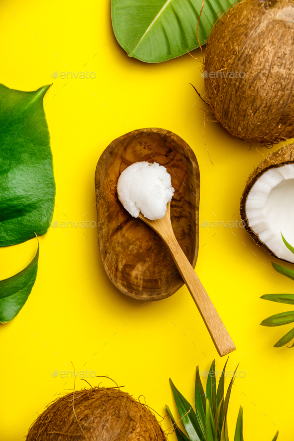 Coconut oil, tropical leaves and fresh coconuts - Stock Photo - Images